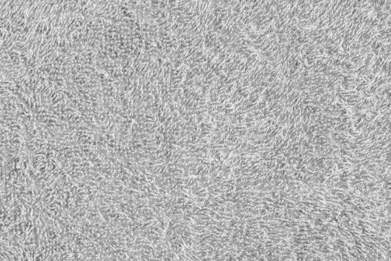 Toalla blanca en fondo con cierre de la textura para arriba imagen de archivo