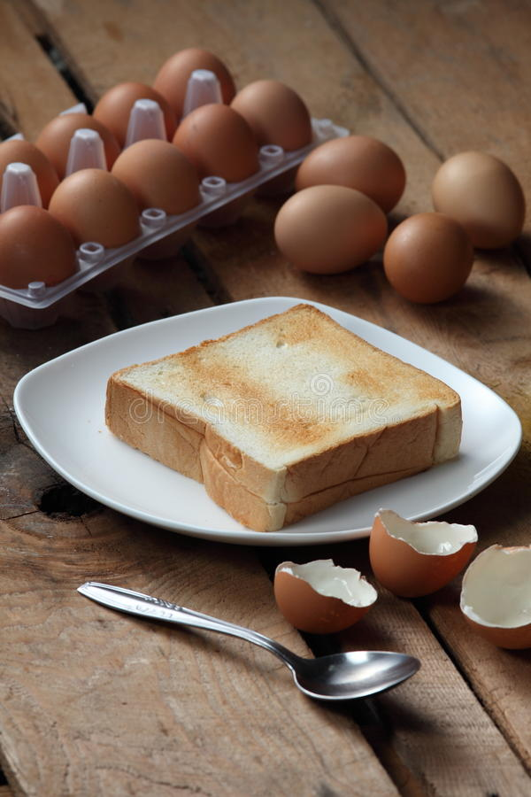 Toast. A sliced toasted bread with eggs as background stock photo