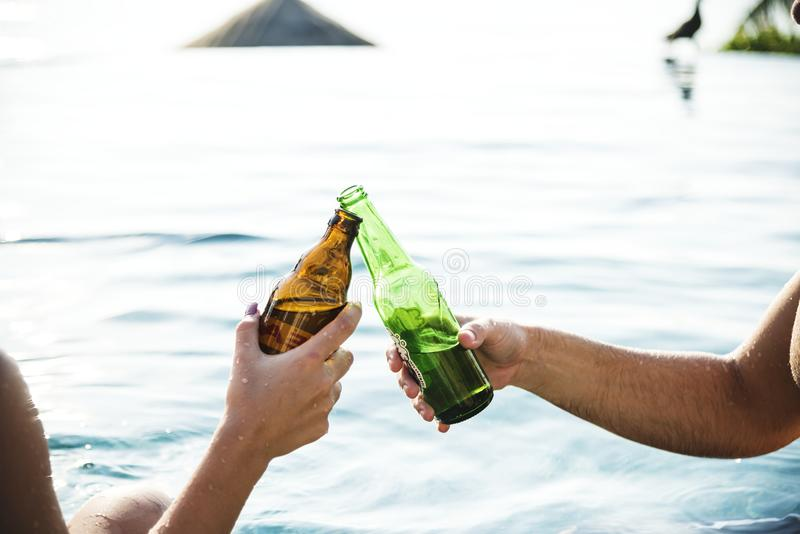 A toast with beer bottles royalty free stock photography
