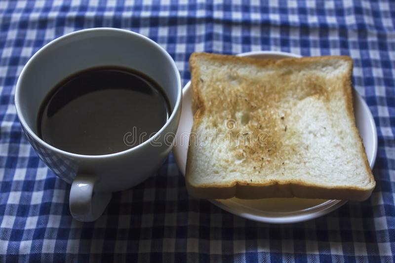 Toast and Black Coffee in Glass stock photography
