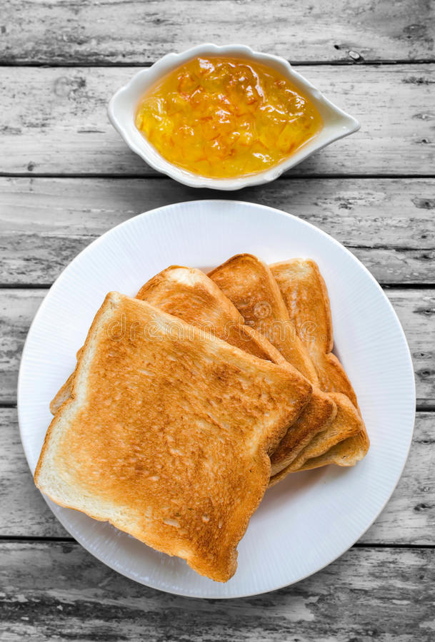 Toast bread with orange jam royalty free stock photography