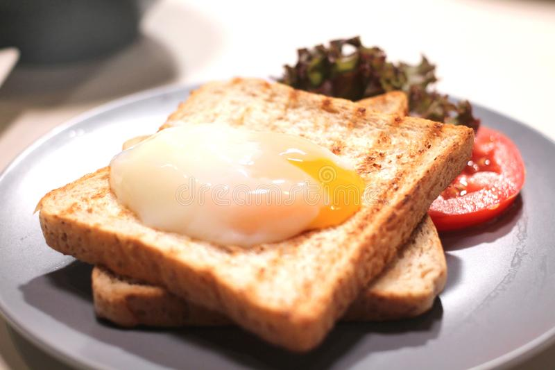Toast bread with poached egg for breakfast royalty free stock photos