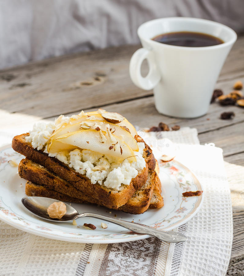 toast for breakfast with sweet cream cheese and pear,coffee, rustic stock photo