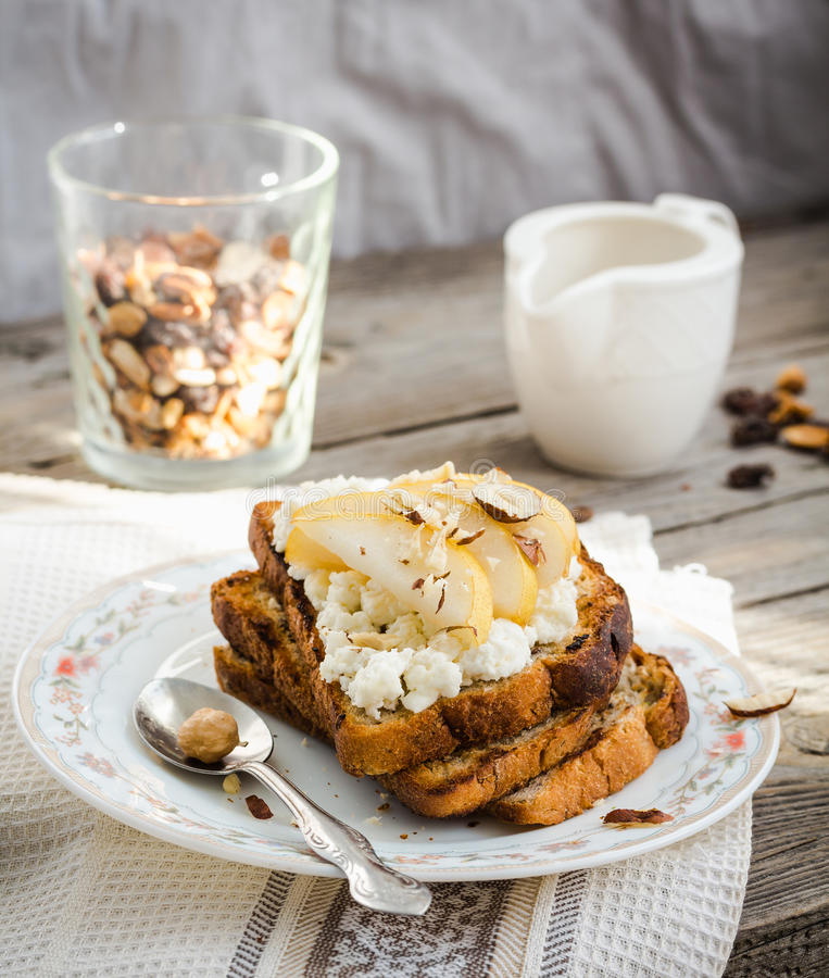 toast for breakfast with sweet cream cheese and pear,coffee, rustic royalty free stock image