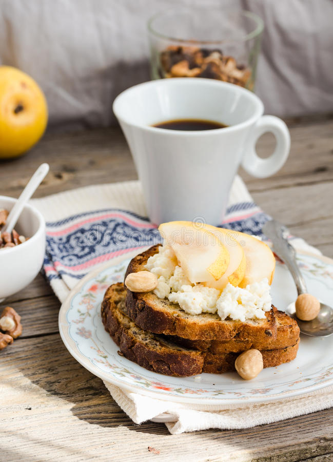 Toast for breakfast with sweet cream cheese and pear, coffee royalty free stock photo