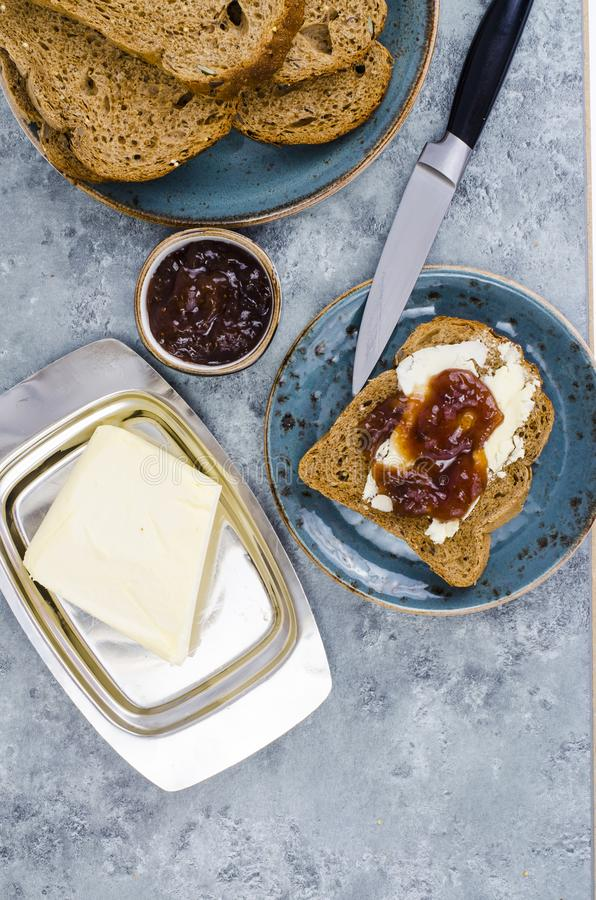 Toast with butter and jam for breakfast on table royalty free stock photos