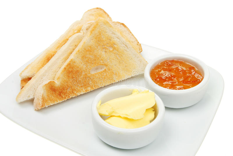 Toast butter and marmalade stock photos