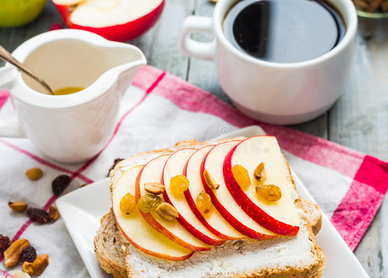 Toast with cheese, apple and dried fruit, coffee, breakfast stock photos