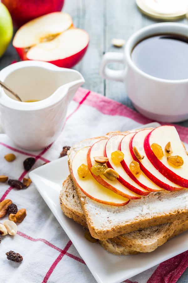 Toast with cheese, apple and dried fruit, coffee, breakfast royalty free stock photos