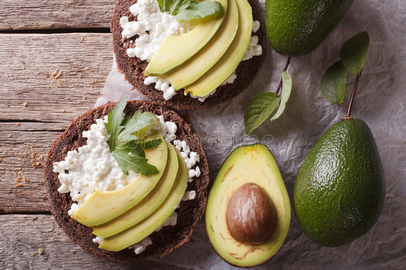 Toast with cream cheese and avocado close-up. horizontal top view royalty free stock images