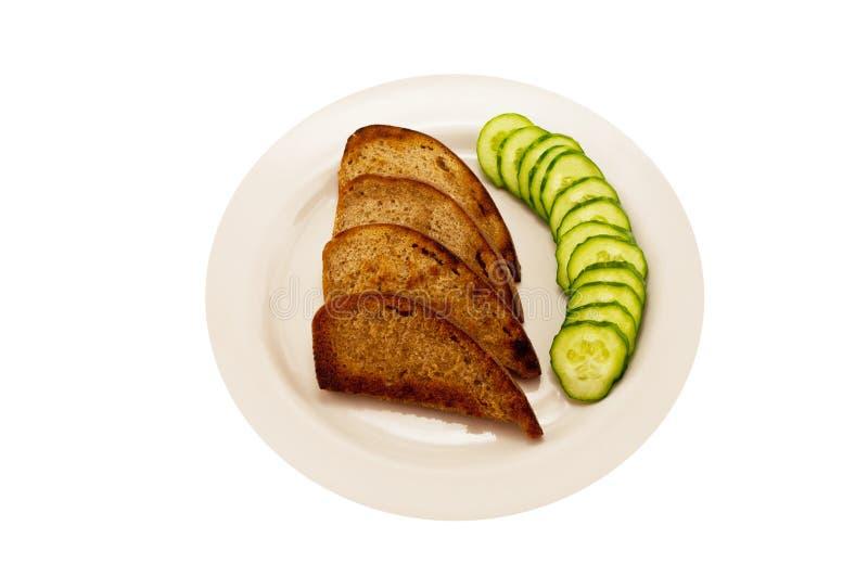 Toast and cucumber green stock photos