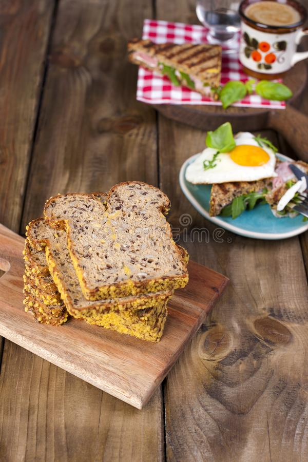 Toast with egg and bacon, fragrant coffee. Fitness bread. Healthy eating. Tasty breakfast.  stock image