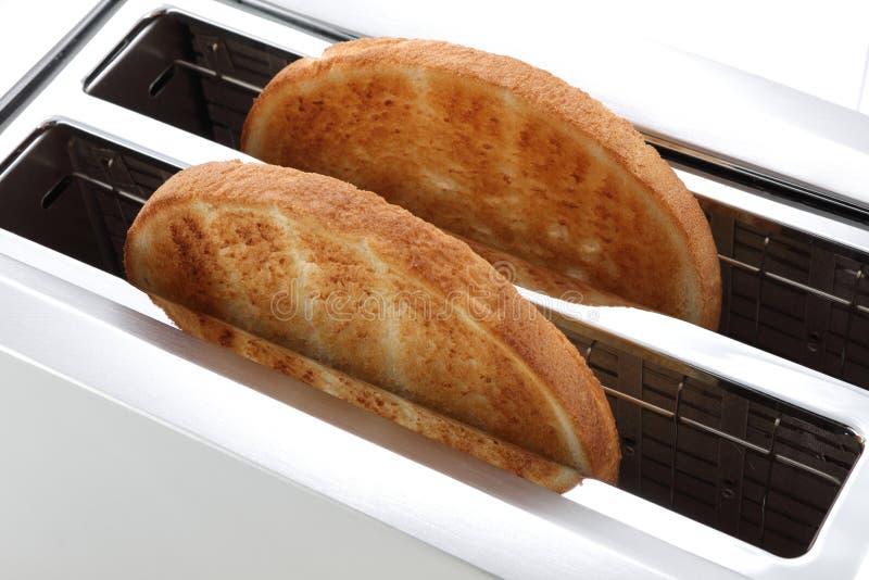 Toast in einem goldenen Braun der Scheiben des Toasters zwei stockfotografie