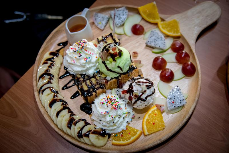 Fruit honey toast. dessert on the wood plate that is Toast and i royalty free stock photo