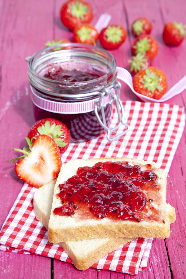 Toast with jam. On picnic tablecloth stock photography