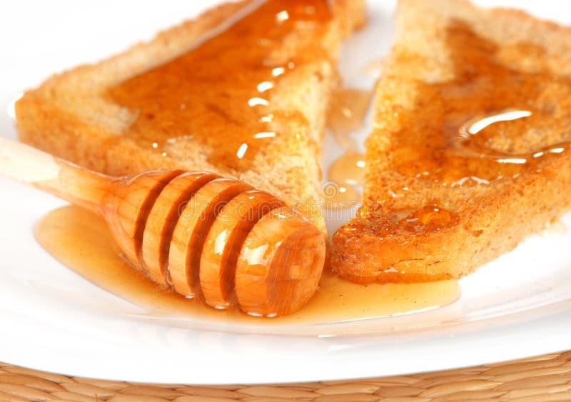 Toast mit Honig stockfotografie