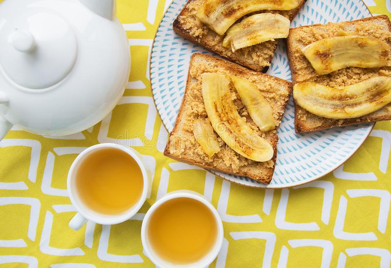 Toast with peanut butter and fried banana, delicious breakfast royalty free stock photography