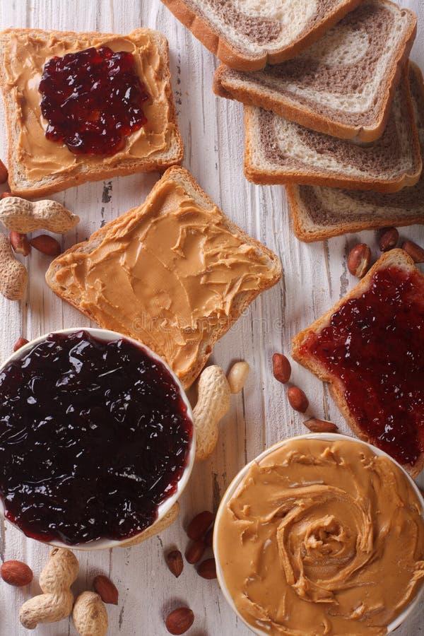 Toast with peanut butter and jam closeup. vertical top view stock photos