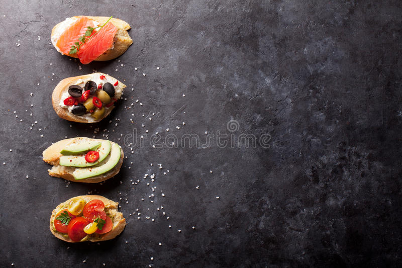 Toast sandwiches with avocado, tomatoes, salmon royalty free stock images