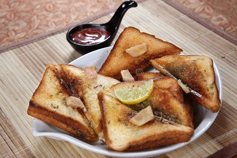 Ulund dal ka tasty toast, Ulundu tasty toast, White gram tasty toast. Toast is sliced bread that has been browned by exposure to radiant heat. This browning is stock image