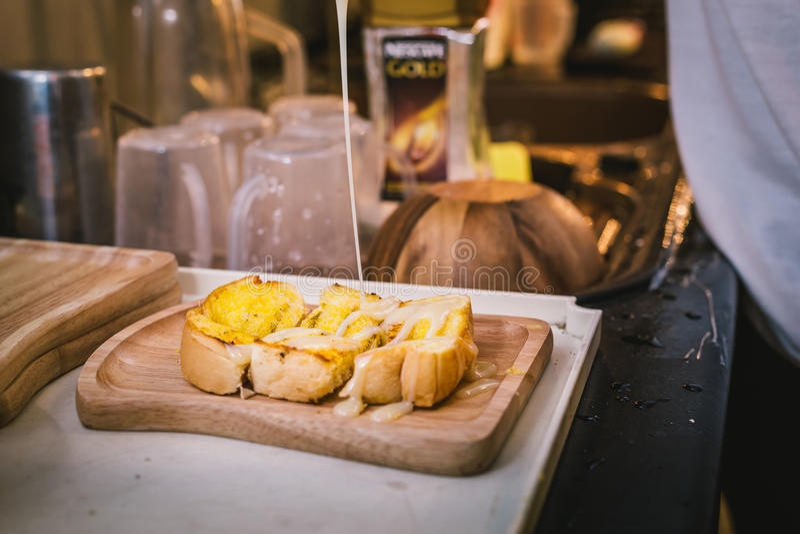 Toast with sweet condensed milk stock photo