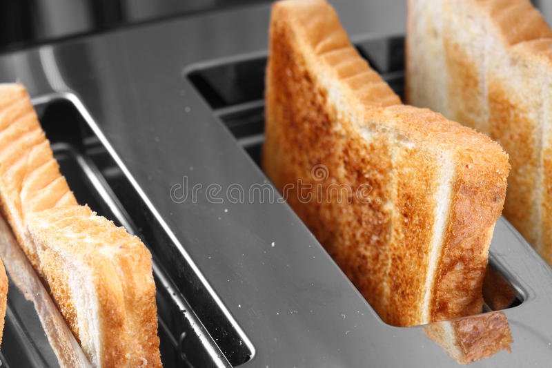 Toast in toaster. Slices of toast in a toaster stock photos