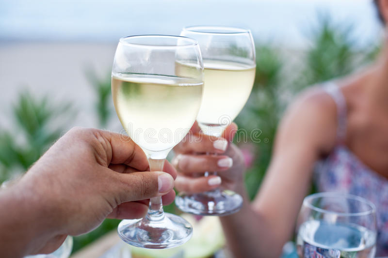 Toast for two to the sea. Toast for two to the sea during dinner royalty free stock photo