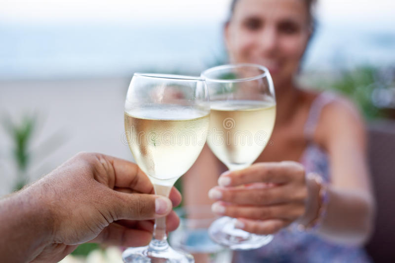 Toast for two to the sea. Toast for two to the sea during dinner royalty free stock image
