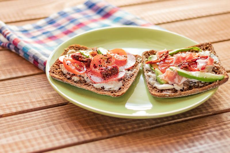 Toast with vegetables and ham royalty free stock photo