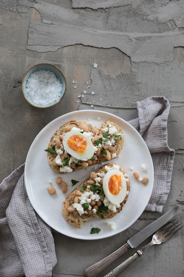 Toast with white beans and egg stock photography