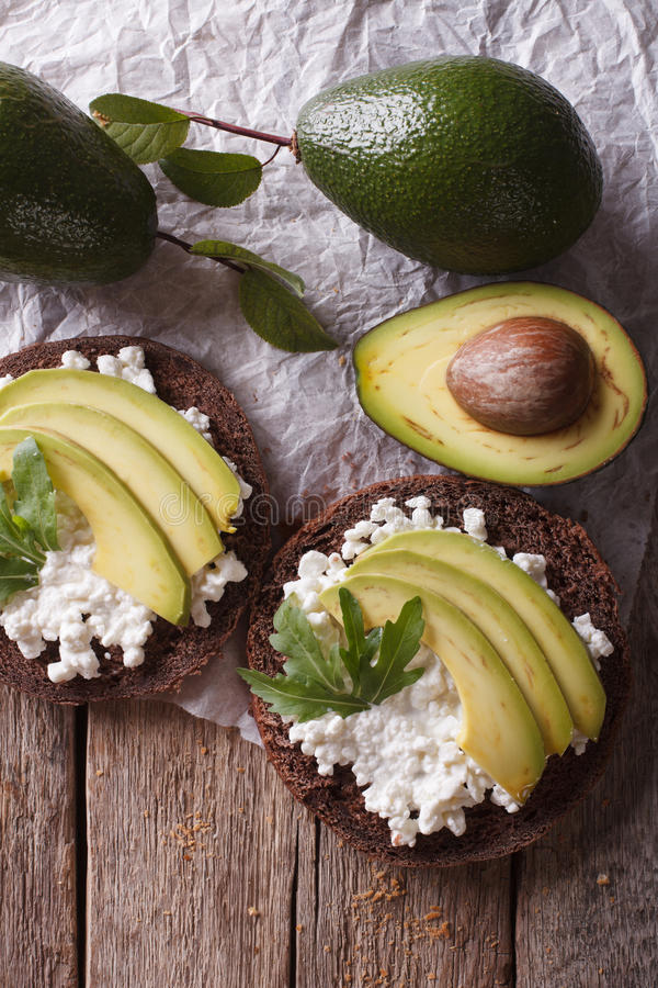 Free Toast With Cream Cheese And Avocado Close-up. Vertical Top View Stock Photo - 59285490
