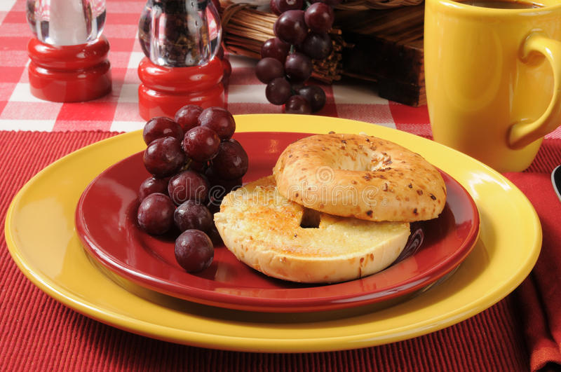 Toasted bagel with grapes royalty free stock images