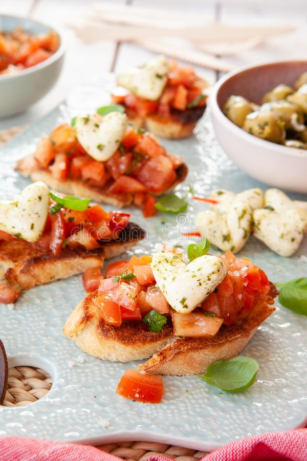 Toasted baguette with tomatoes and cheese stock photography