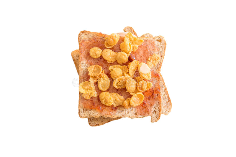 Toasted bread fill with strawberry jam and sweet cornflakes, isolated on white background stock photo