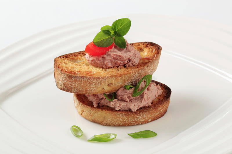 Toasted bread and pate royalty free stock photo