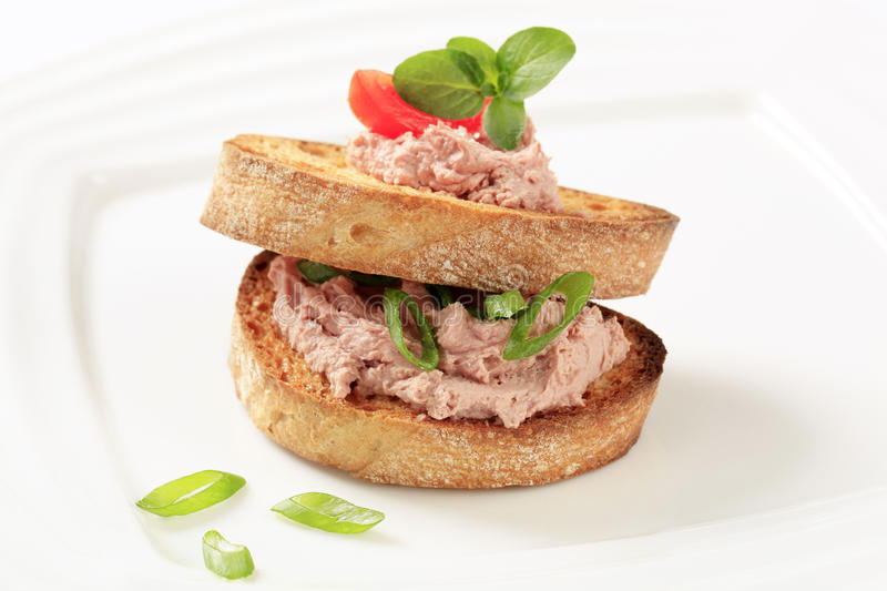 Toasted bread with pate royalty free stock photo