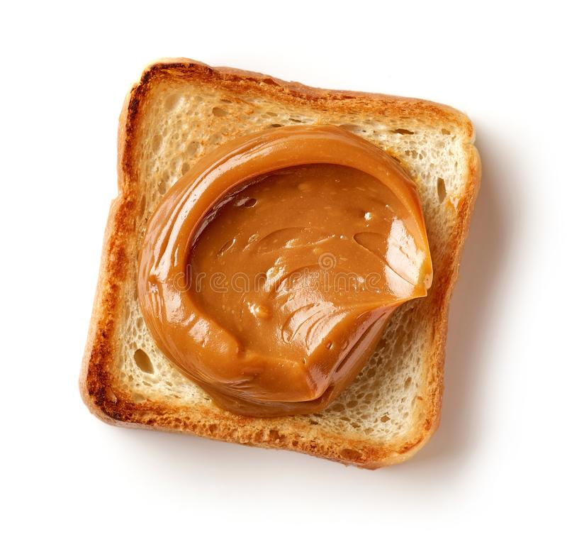 Toasted bread slice with melted caramel stock images