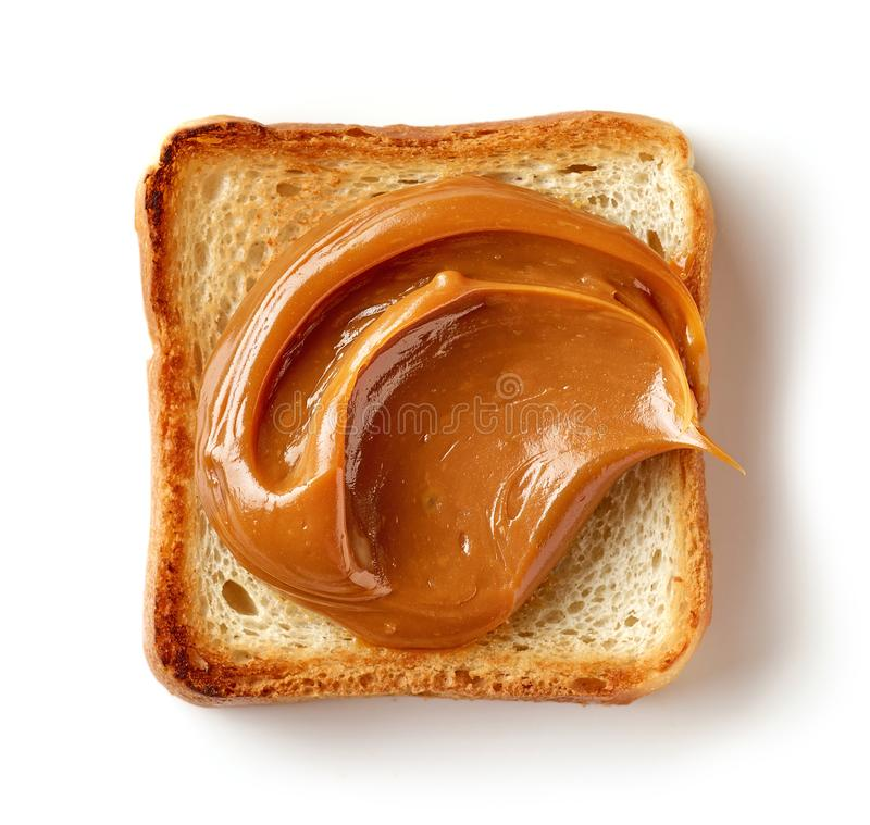 Toasted bread slice with melted caramel royalty free stock photography