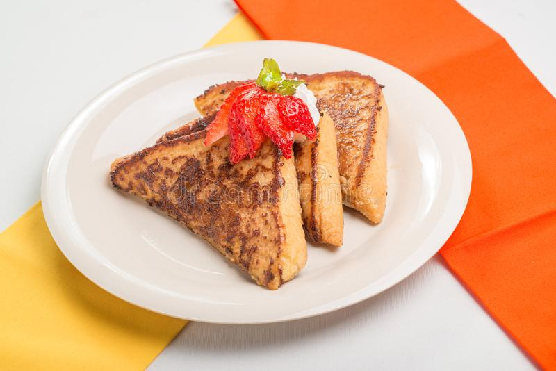 Toasted Bread topped with a strawberry royalty free stock images