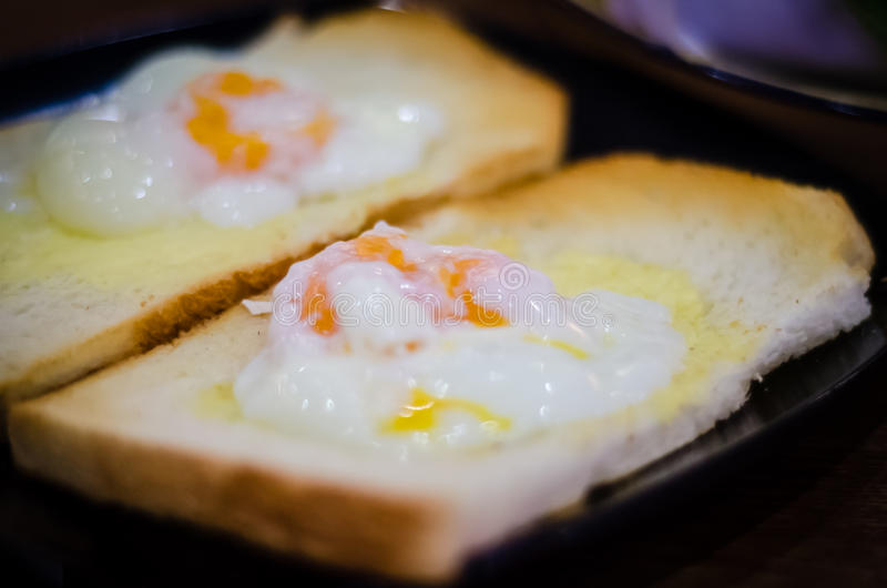 Toasted Breads. On plates with half-boiled egg on it stock images
