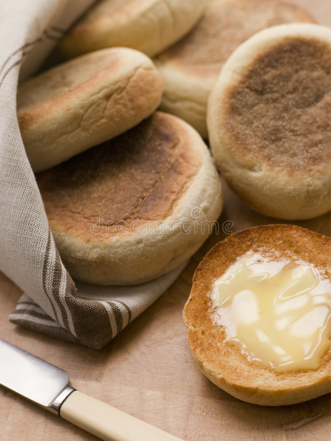 Toasted English Muffins with Butter stock photography