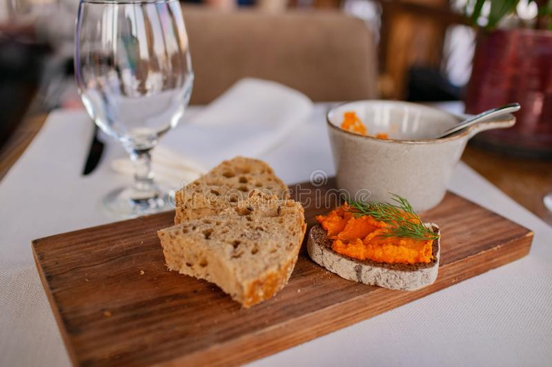 Toasted rye bread with boiled squash pate. royalty free stock photography
