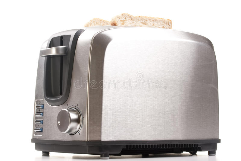 Toaster. A toaster and a special bread for toast stock images