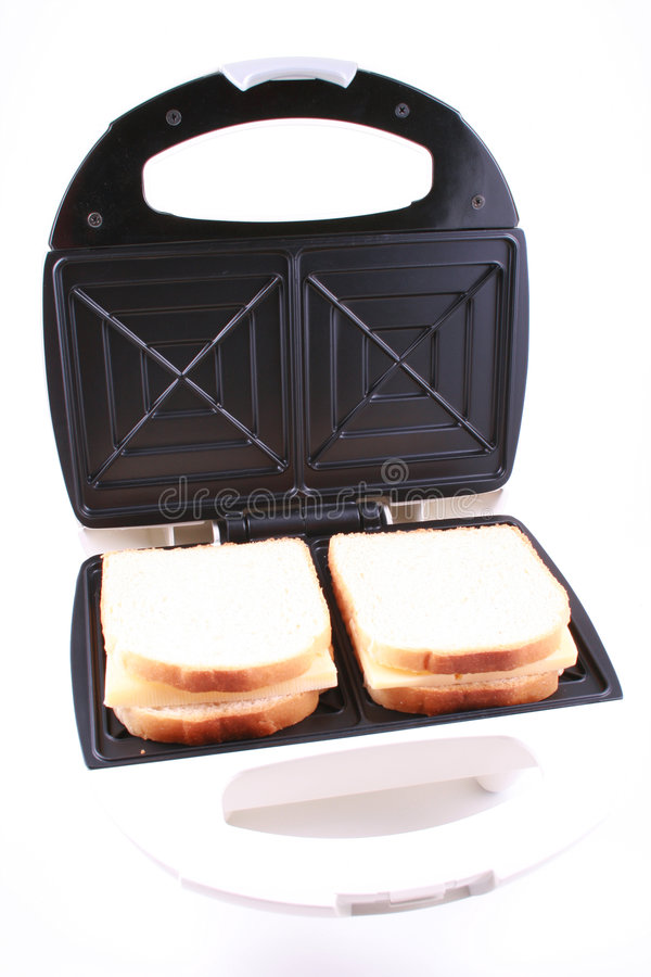 Toaster. And some fresh bread ready to do breakfast stock photos