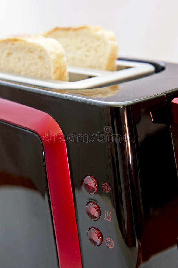 Toaster. Two sliced bread in a toaster. Focus on toaster indicators royalty free stock photos