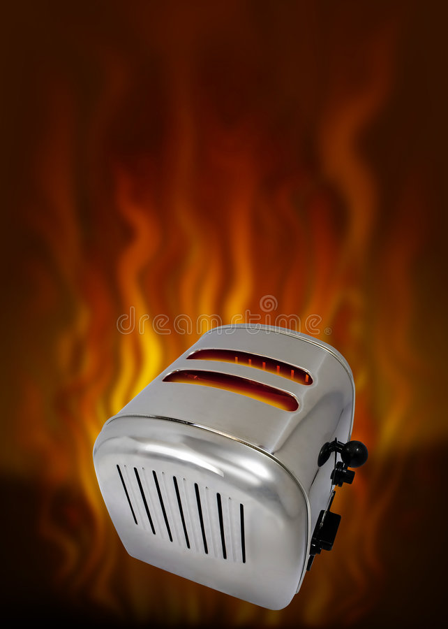 Toaster. Hot toaster with flames in background royalty free stock photos