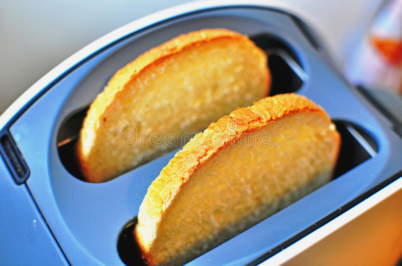 Toaster with bread. The toaster with bread slices stock photo