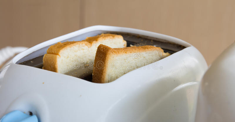 Toaster with bread slices royalty free stock photography