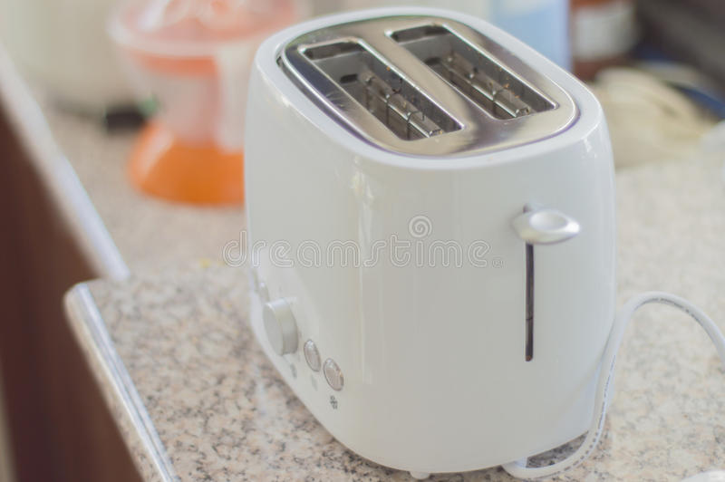 Toaster. Closeup picture of toaster in kitchen stock images