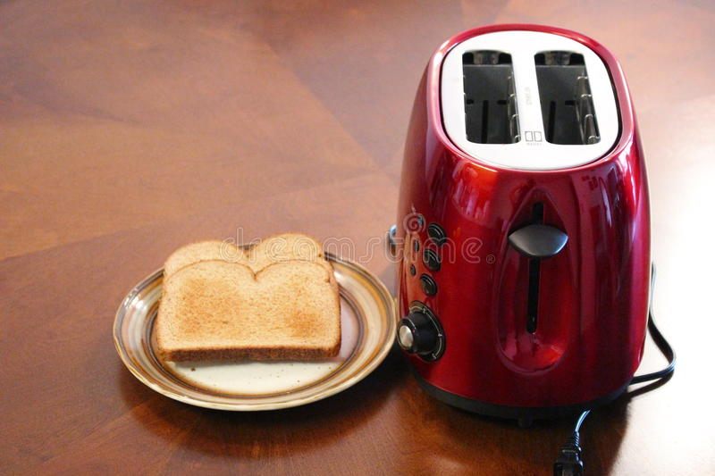 Toaster. Electric red toaster with toasters royalty free stock photography